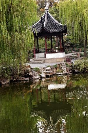 Ancient Chinese Pagoda Reflection Green Willows Garden of the Humble Administrator, Zhouzheng Yuan, Water, Suzhou, Jiangsu, China  Built in the 1500s photo