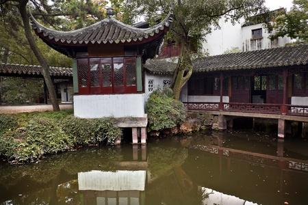 Song Feng Shui Ge, Pine Tree Wind Water Pagoda, Ancient Red Pagoda House Terrace Reflection on Water Garden of the Humble Administrator, Zhouzheng Yuan, Suzhou, Jiangsu, China  Built in the 1500s photo