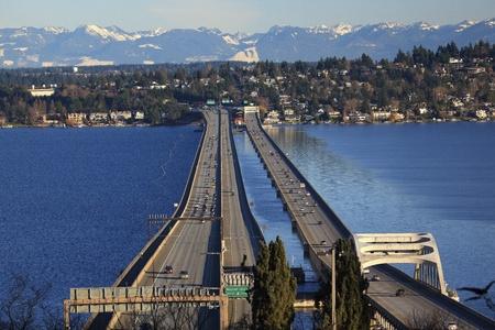cascades: I-90 Bridge Seattle Mercer Island Highway Cars Snowy Cascade Mountains Bellevue Washington State Pacific Northwest