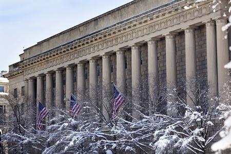 commerce: Commerce Department After the Snow Flags Pennsylvania Avenue Washington DC Stock Photo