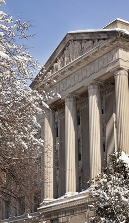 Commerce Department Statues Columns After the Snow Washington DC Stock Photo - 8888760