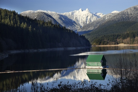 Capilano Reservoir Lake Green Building Dam Snowy Two Lions Snow Mountains Vancouver British Columbia Pacific Northwest photo