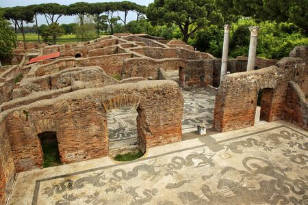 Ancient Roman Baths of Neptune Mosaic Floors Ostia Antica Ruins Rome ItalyExcavation of Ostia, ancient Roman port, next to airport.  Was port for Rome until 5th Century AD.