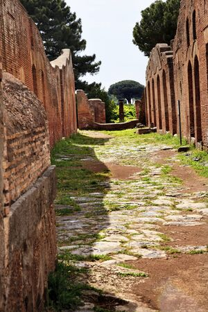 Ancient Roman Road Ruins Ostia Antica Ruins Rome ItalyExcavation of Ostia, ancient Roman port, next to airport.  Was port for Rome until 5th Century AD.  photo