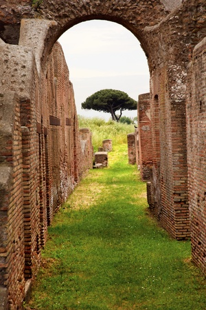Ancient Roman Arch Walls Street Ostia Antica Ruins Rome ItalyExcavation of Ostia, ancient Roman port, next to airport.  Was port for Rome until 5th Century AD.