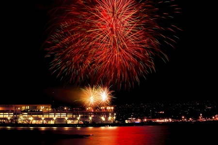 canadian pacific: Red Green Fireworks Vancouver Harbor Canada Day British Columbia Pacific Northwest Editorial