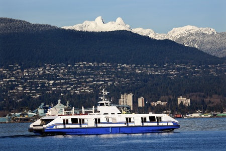 Vancouver Harbor Ferry Freighter Snowy Two Lions Snow Mountains British Columbia Pacific Northwest photo