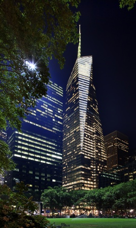 Bryant Park New York City Green Grass Skyline Apartment Buildings Bank of America Building Night Editorial