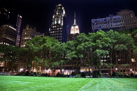 bryant park: Bryant Park New York City Green Grass Skyline Apartment Buildings Empire State Building Night