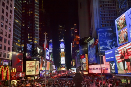 EDITORIAL Times Square Lightshow, Advertising, Plays, People Cars Crowds New York City Skyline Night