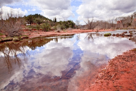 downstream: Oak Creek Downstream Fair Weather Reflection  Sedona Arizona Stock Photo