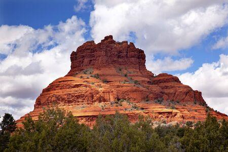Bell Rock Butte Orange Red Rock Canyon Blue Cloudy Sky Green Trees Snow Sedona Arizona photo