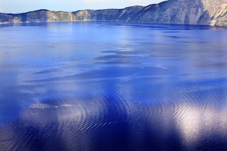 northwest: Colorful Waters Blue Crater Lake Reflection Oregon Pacific Northwest Stock Photo