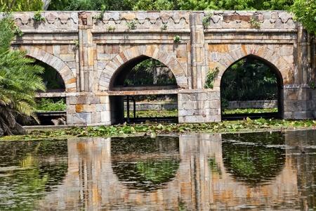 17th:  Athpula Eight Piers Stone Bridge Reflection Lodi Gardens New Delhi India 17th Century Bridge Stock Photo