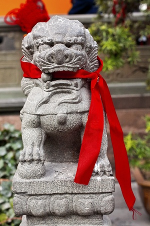 jade buddha temple: Stone Dragon Red Ribbons Buddhist Sayings Jade Buddha Temple Jufo Si Shanghai China Most famous buddhist temple in Shanghai Stock Photo