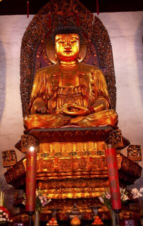 Gold Buddhist Statue Jade Buddha Temple Jufo Si Shanghai China Most famous buddhist temple in Shanghai photo