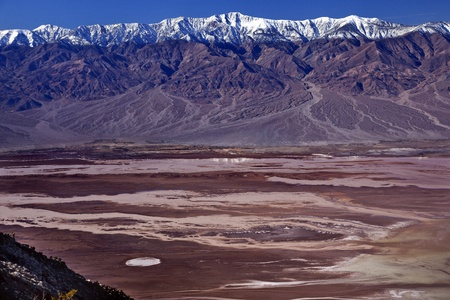 valley below: Salt Badwater Basin Panamint Mountains from Dantes View Death Valley National Park California Lowest spot in the Western Hemisphere 282 Feet below Sea Level from Highest Point in Death Valley Stock Photo