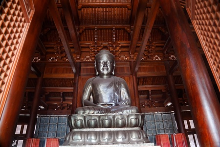 spirtual: Silver Buddha in Wooden Hall Jing An Tranquility Temple Shanghai China Richest Buddhist temple in Shanghai Editorial