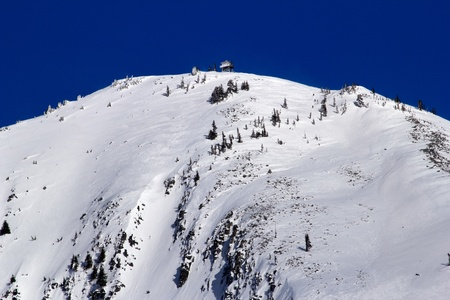 Sking Down Snowy Granite Mountain from Fire Lookout Tower Snoqualme Pass Washington photo