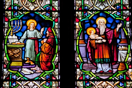 Baby Jesus with Joseph and Young Jesus Teaching Stained Glass in National Shrine of Saint Francis of Assisi San Francisco California   Church has relics of St Francis   This church was founded in 1849 and rededicated in 1919 after church was destroyed in  photo