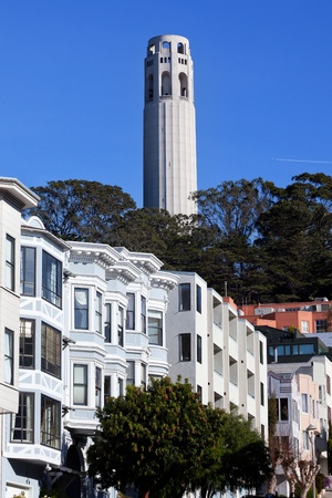 coit tower: Coit Tower Row Houses San Francisco California on Telegraph Hill   Airplane in the background  Coit Tower was built in 1933   Little Hitchcock Coit left one third of her estate to the City to build the Tower
