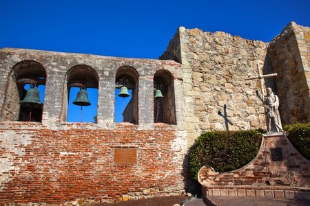 Mission San Juan Capistrano Church Ruins in California   Brass Bells and Statue of Father Junipero Serra, who founded the Mission in 1775   Church was destroyed in 1812 by earthquake