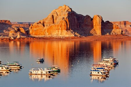 lake powell: Castle Rock Reflection Wahweap Bay Marina House Boats Lake Powell Glen Canyon Recreation Area Arizona Stock Photo