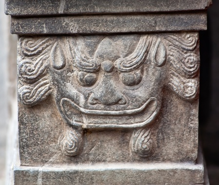 China Dragon Door Stone Houhai Beijing, China   China door stones were used to symbolize status of officials under Emperor  photo