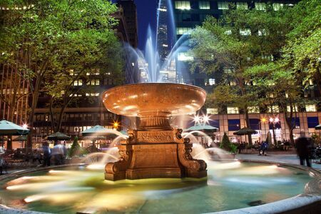 Fountain Bryant Park New York City Apartment Buildings Night Faces blurred trademarks removed