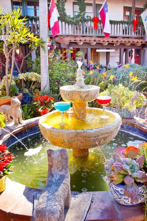Fountain Margarita Glasses Flowers Garden Cactus Mexican Food Culture Old San Diego California Trademarks obscured  Stock Photo - 14570548