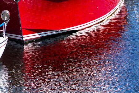 northwest: Red Sailboat Reflection, Gig Harbor, Pierce County, Puget Sound, Washington State Pacific Northwest Stock Photo