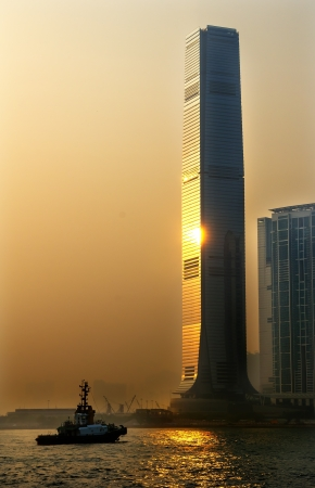 icc: Inernational Commerce Center ICC Building Kowloon Hong Kong Harbor Tugboat, Sunset 4th Largest Building in the World