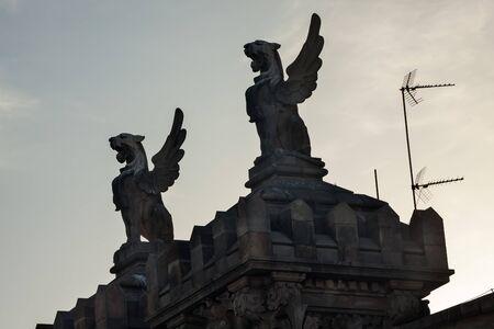 Stone Griffins on Top of Rooftop, La Rambla, Barcelona, Spain    Banco de Imagens