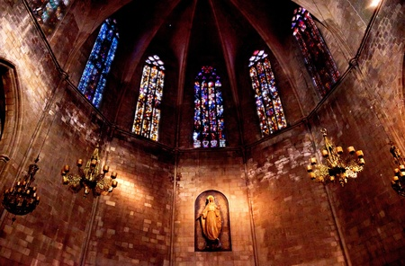pi: Stained Windows and Mary Statue in Old Stone Basilica, St Maria del Pi, Saint Mary of Pine Tree, in Barcelona, Spain  Saint Maria del Pi was founded in 987AD or earlier  One of the oldest churches in Barcelona