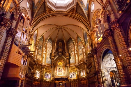 invaded: Basilica Inside Monestir Monastery of Montserrat, Barcelona, Catolonia, Spain.  Founded in the 9th Century, destroyed in 1811 when French invaded Spain. Rebuilt in 1844 and now a Benedictine Monastery.  Placa de Santa Maria