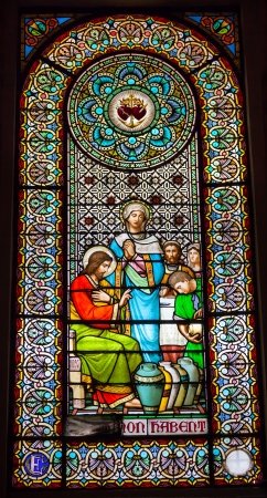 Stained Glass Window Jesus Mary Turning Water to Wine Cana Basilica Inside Monestir Monastery of Montserrat, Barcelona, Catolonia, Spain.  Founded in the 9th Century, destroyed in 1811 when French invaded Spain. Rebuilt in 1844 and now a Benedictine Monas