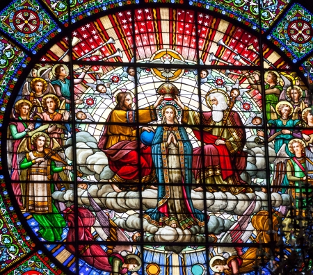 Stained Glass Jesus Crowning Mary Angels God the Father Rose Window Basilica Inside Monestir Monastery of Montserrat, Barcelona, Catolonia, Spain.  Founded in the 9th Century, destroyed in 1811 when French invaded Spain. Rebuilt in 1844 and now a Benedict
