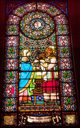 invaded: Stained Glass Baby Jesus Mary Rabbi Basilica Inside Monestir Monastery of Montserrat, Barcelona, Catolonia, Spain.  Founded in the 9th Century, destroyed in 1811 when French invaded Spain. Rebuilt in 1844 and now a Benedictine Monastery.  Placa de Santa M