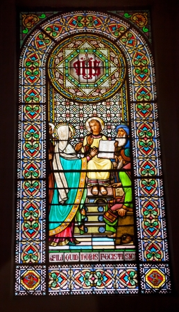 invaded: Stained Glass Window Young Jesus Teaching Temple Mary Basilica Inside Monestir Monastery of Montserrat, Barcelona, Catolonia, Spain.  Founded in the 9th Century, destroyed in 1811 when French invaded Spain. Rebuilt in 1844 and now a Benedictine Monastery.