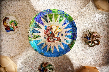 guell: Antoni Gaudi ceramic mosaic design in Guell Park, Barcelona, Catalonia, Spain   Guell Park is a residential complex designed by Antnoi Gaudi between 1900-1914, which is now a public park   Stock Photo