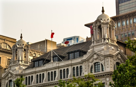 best location: Three On the Bund Old Buildings and Modern Buildings on The Bund in the Old Part of Shanghai China   This is one of the most famous buildings on the Bund and the location of many of the best restaurants in Shanghai   Trademarks obscured