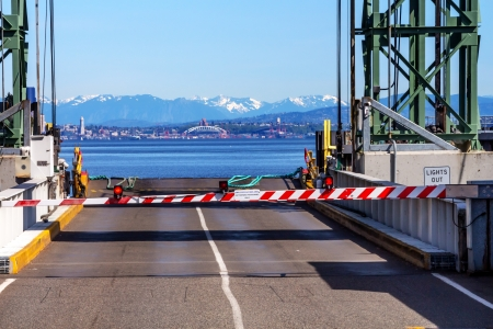 Bainbridge Island Ferry Dock Gate Puget Sound Seattle Cascade Mountains in Distance Kitsap County Washington State Pacific Northwest  photo