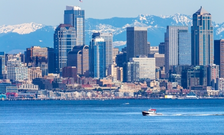 Seattle Skyline Motorboat Puget Sound Cascade Mountains Washington State Pacific Northwest photo