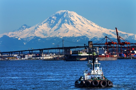 Tug Boat Seattle Port with Red Cranes West Seattle Bridge, and Mount Rainier in the Background  photo