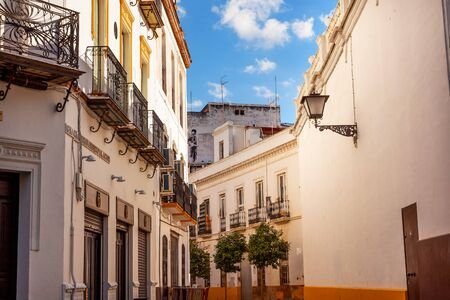 matador: Matador Painting Narrow Streets of Seville, Street Lamp Balconies Yellow White Cityscape, City View Andalusia Spain      Stock Photo