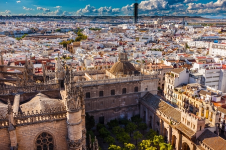bull ring: Cityscape, City View, from Giralda Spire, Bell Tower, Orange Garden, Seville Cathedral, Andalusia Spain   Built in the 1500s   Largest Gothic Cathedral in the World and Third Largest Church in the World   Bull Ring in distance  Stock Photo