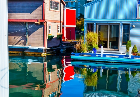 Floating Home Village Red Blue Brown Houseboats Fisherman
