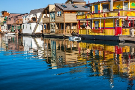 canadian pacific: Floating Home Village Yellow Brown  Houseboats Fisherman