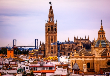 cathedral: Giralda Spire Bell Tower Seville Cathedra, Cathedral of Saint Mary of the See Church of El Salvador Seville, Andalusia Spain   Giralda is largest Gothic Cathedral in the World and burial Place of Christopher Columbus