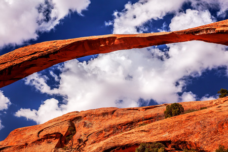devils garden: Landscape Arch Close Up Rock Canyon Devils Garden Blue Sky Arches National Park Moab Utah USA Southwest  Longest and thinnest arch in the world  Stock Photo